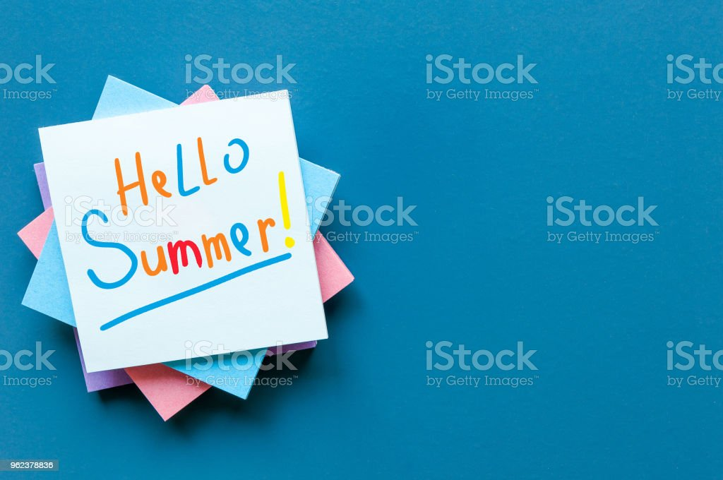 Hello Summer - inscription of many colored letters at notes on blue background. First summer day, Calendar concept. With copy space for text stock photo