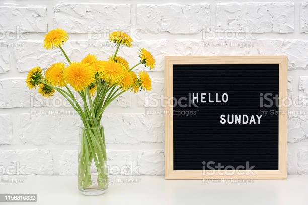 Hello sunday words on black letter board and bouquet of yellow on picture id1158310832?b=1&k=6&m=1158310832&s=612x612&h=eyikhezw3hkxvb7ka2pqbzk8xwepe8nkf cptya9aow=