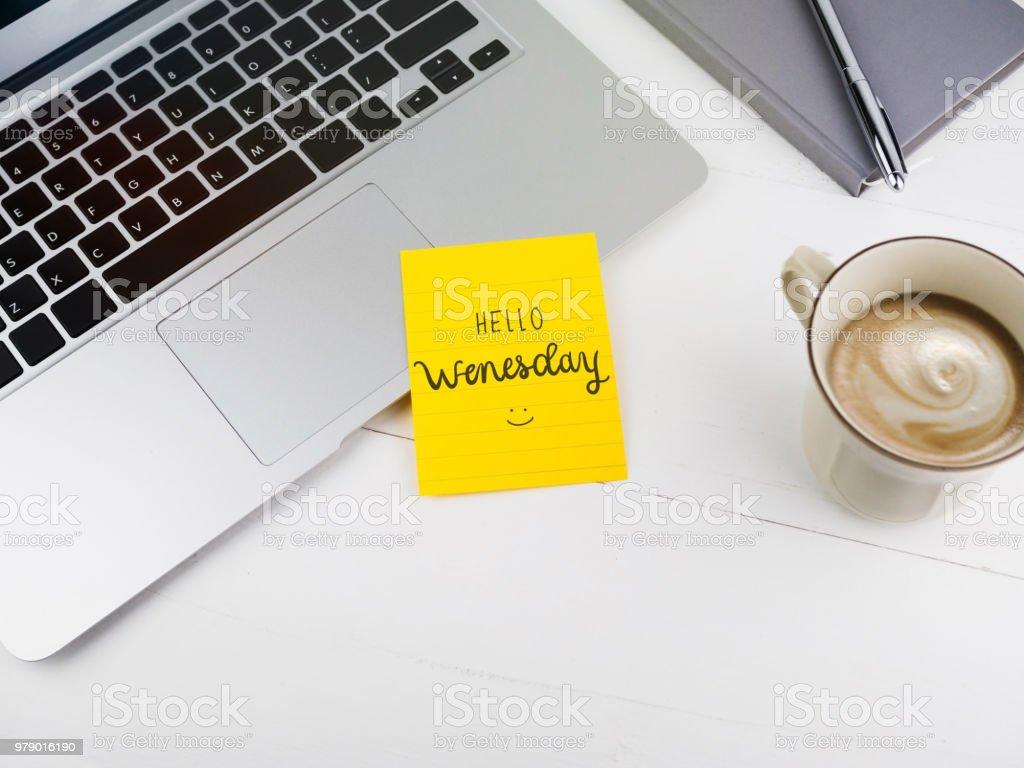 Hello Wednesday text on stick note on work desk stock photo