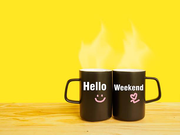hello weekend message on couple coffee or tea cup - glückliche montagszitate stock-fotos und bilder