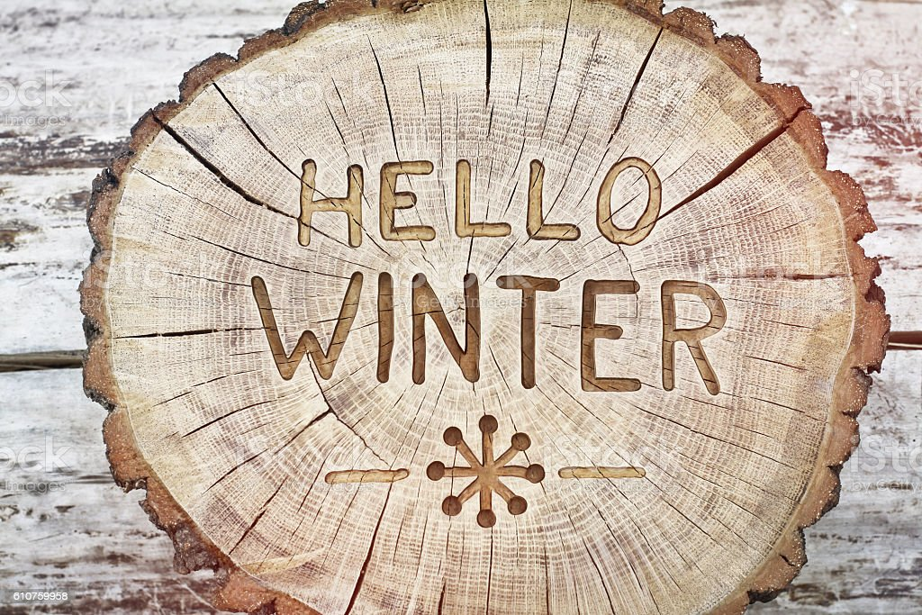 Hello winter. Carving wood for your design. Congratulatory background stock photo