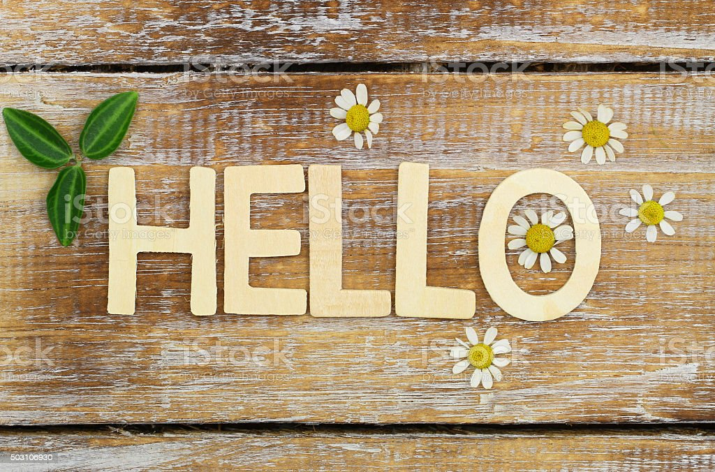 Hello written with wooden letters on rustic surface stock photo