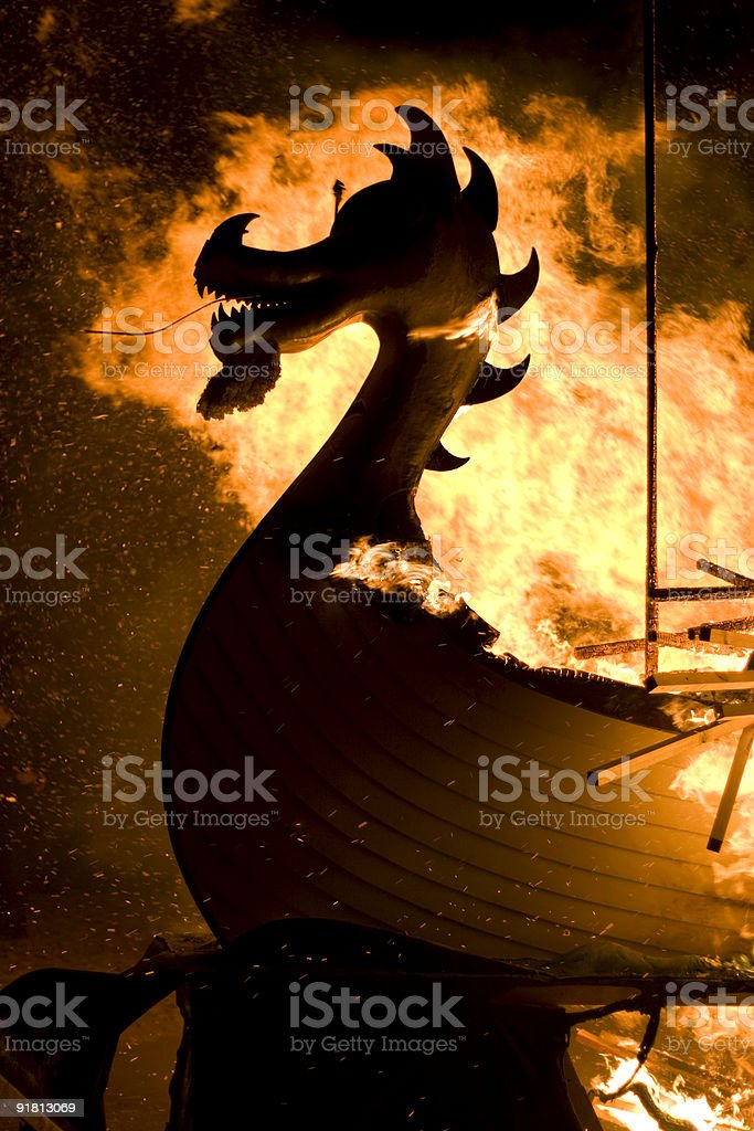 A burning silhouette of a galley ship on the water royalty-free stock photo