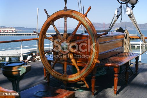 Helm of old sailing ship in San Francisco Bay with Golden Gate Bridge in Background