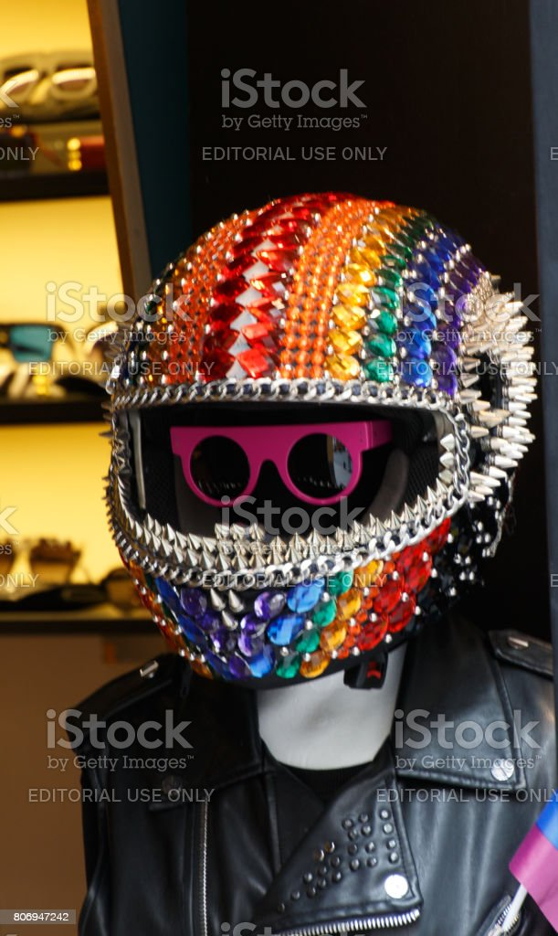 Helmet decorated with the colors of the rainbow flag stock photo