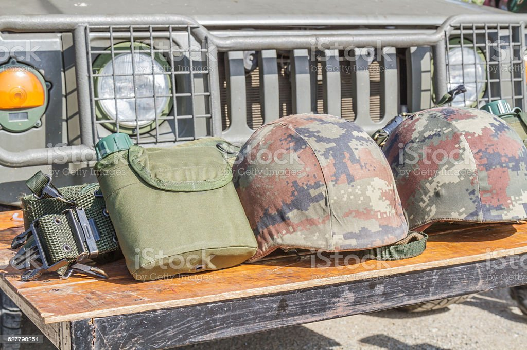 Helmet military and Military flask stock photo