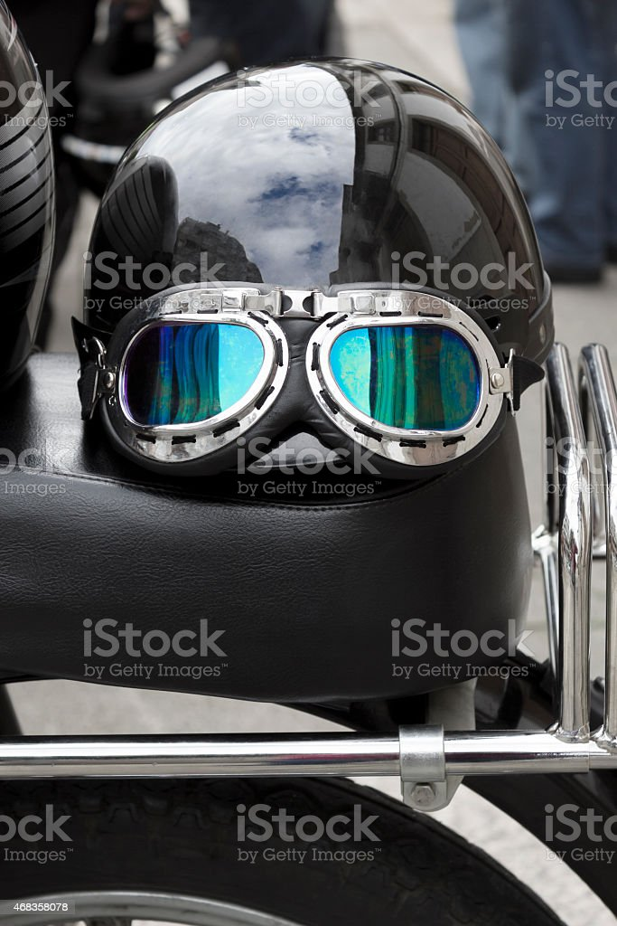 Helmet of a motorist on the saddle royalty-free stock photo