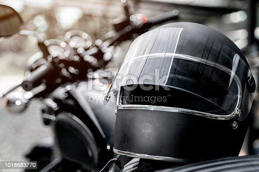 Black helmet on motorcycle seat