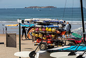 Saint-Malo, France - September 15, 2018:  Helmets and surf boards at the school of surf in Saint Malo, Brittany, France