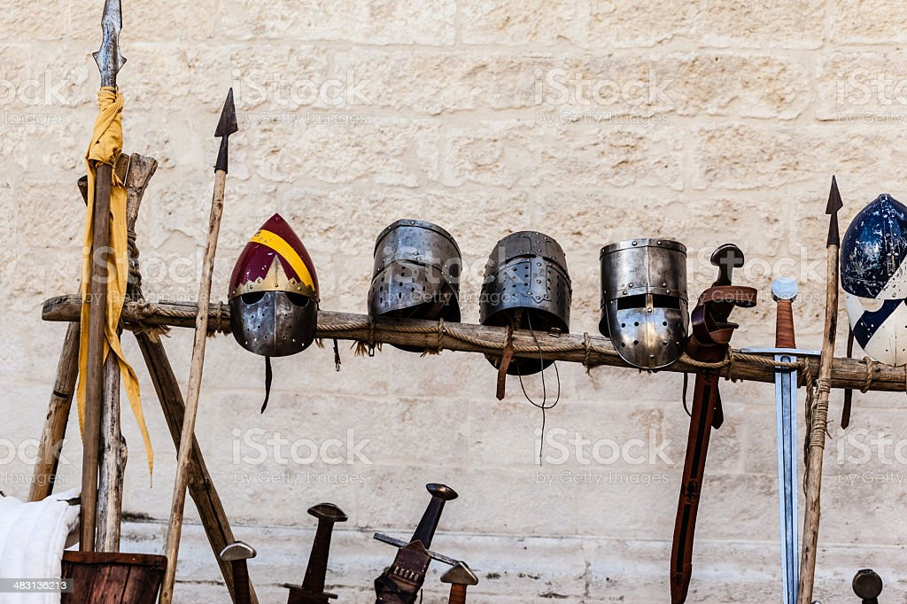 Helmets and swords stock photo