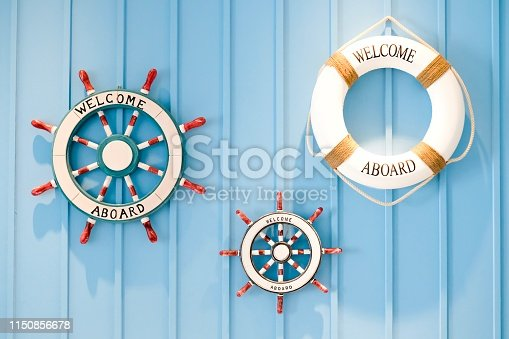 istock Helms and life buoyancy with welcome aboard. 1150856678