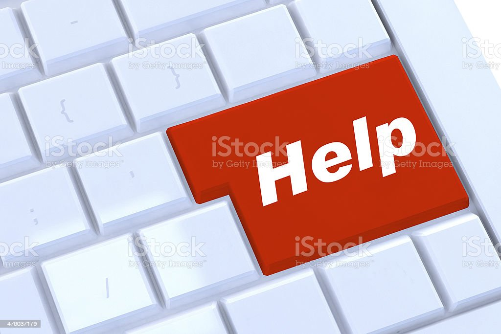 help button in red on a modern silver keyboard royalty-free stock photo