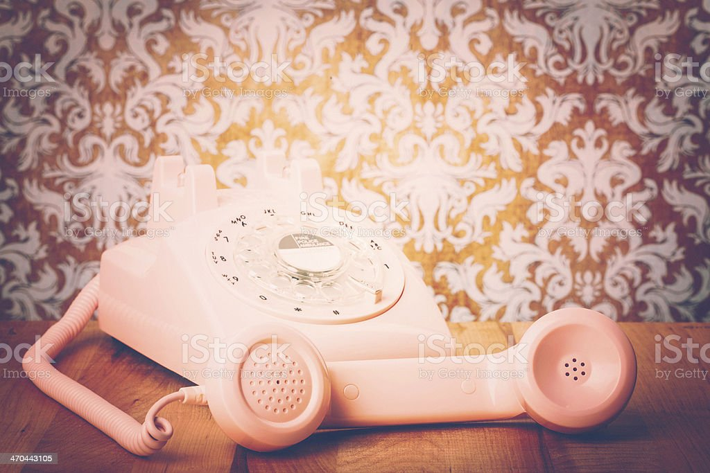 Help Desk with Vintage Pink Phone stock photo