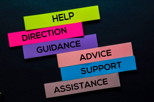 Help, Direction, Guidance, Advice, Support, Advice, Assistance text on sticky notes isolated on Black desk. Mechanism Strategy Concept stock photo