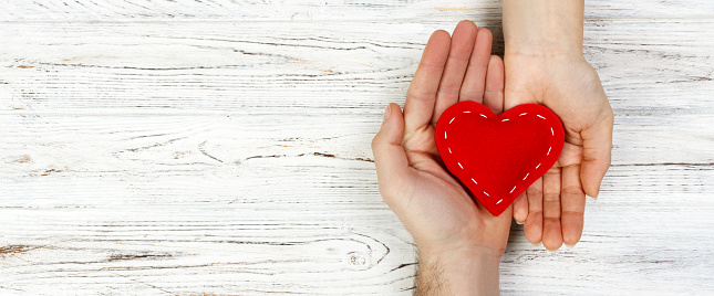 istock help, Heart in Hand on wood background. Valentine day concept. banner for advertising and design, promo top view with copy space 1046031306