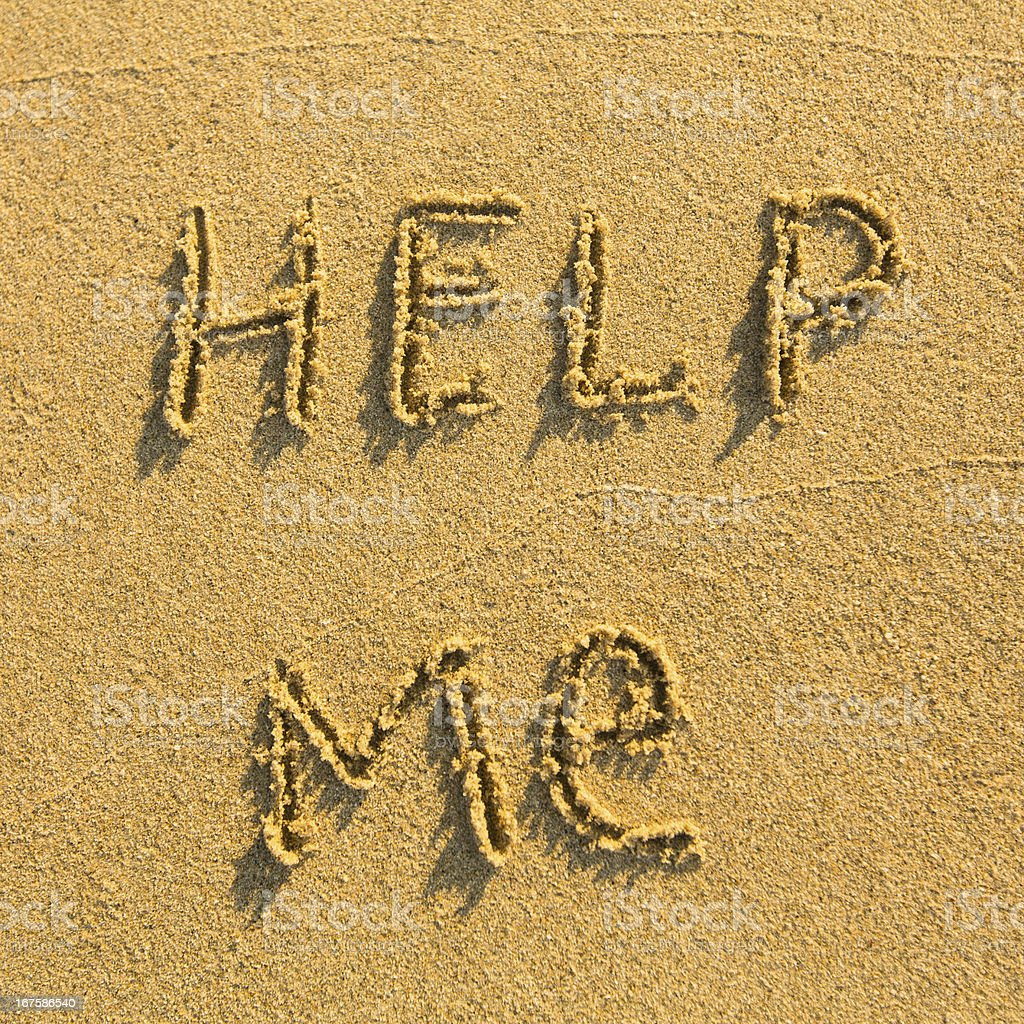 Help me - Inscription on the sand of tropical beach royalty-free stock photo