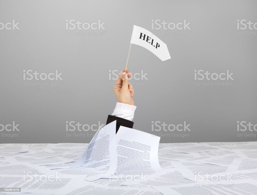 Help Flag in businesswoman hand on table with many papers Adult Stock Photo