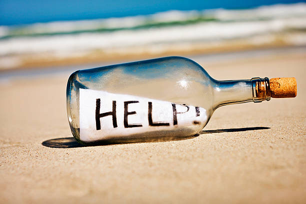 help says frantic message in bottle on deserted beach - stranded stock pictures, royalty-free photos & images