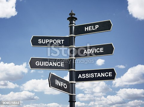 istock Help, support, advice, guidance, assistance and info crossroad signpost 909025844