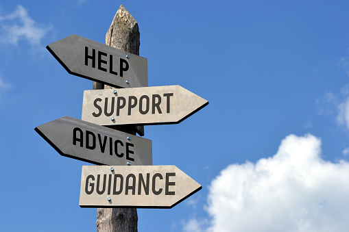istock Help, support, advice, guidance signpost 519749080