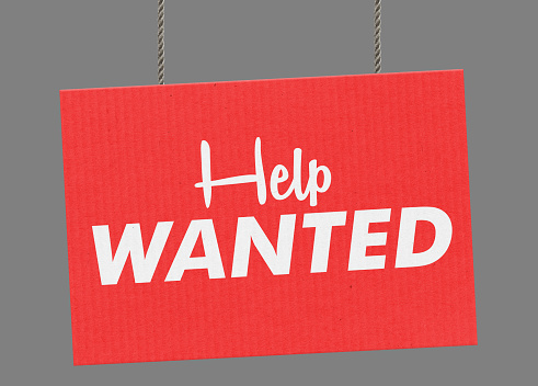 istock Help wanted sign hanging from ropes. Clipping path included so you can put your own background. 925716910