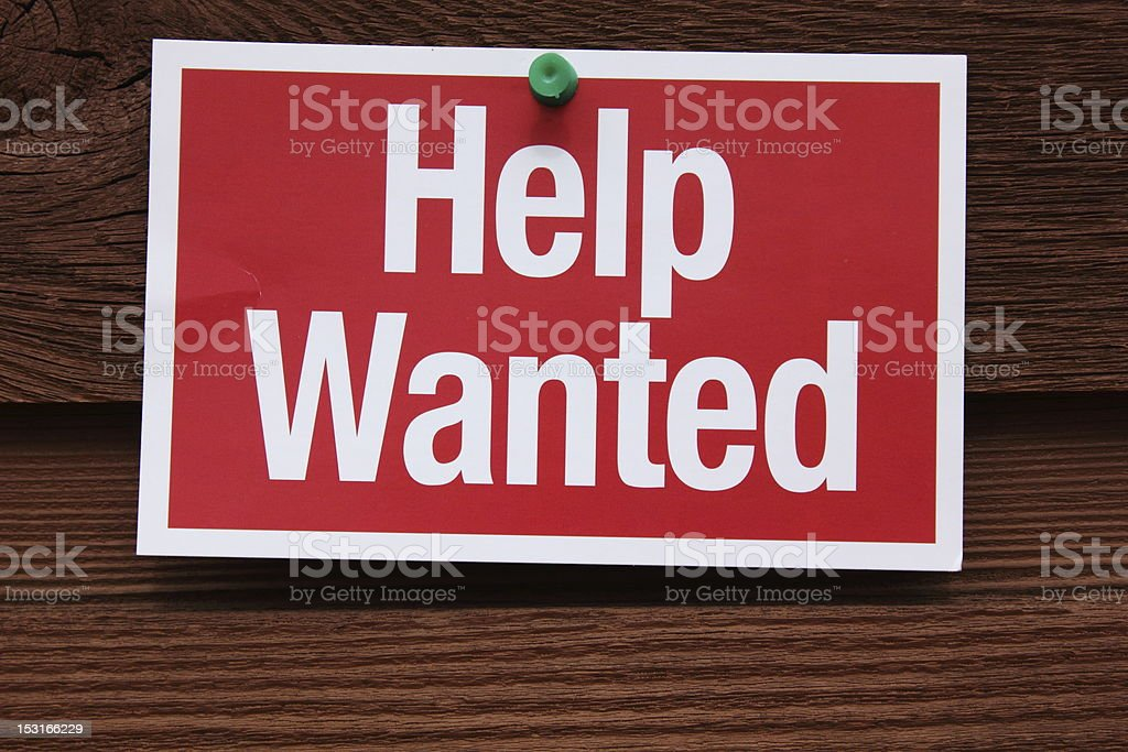 Help Wanted Sign on wooden background stock photo