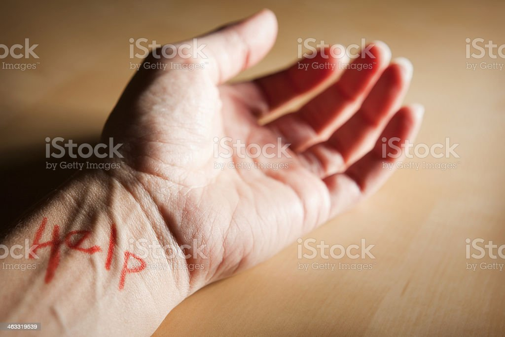Help Written In Red On A Wrist royalty-free stock photo