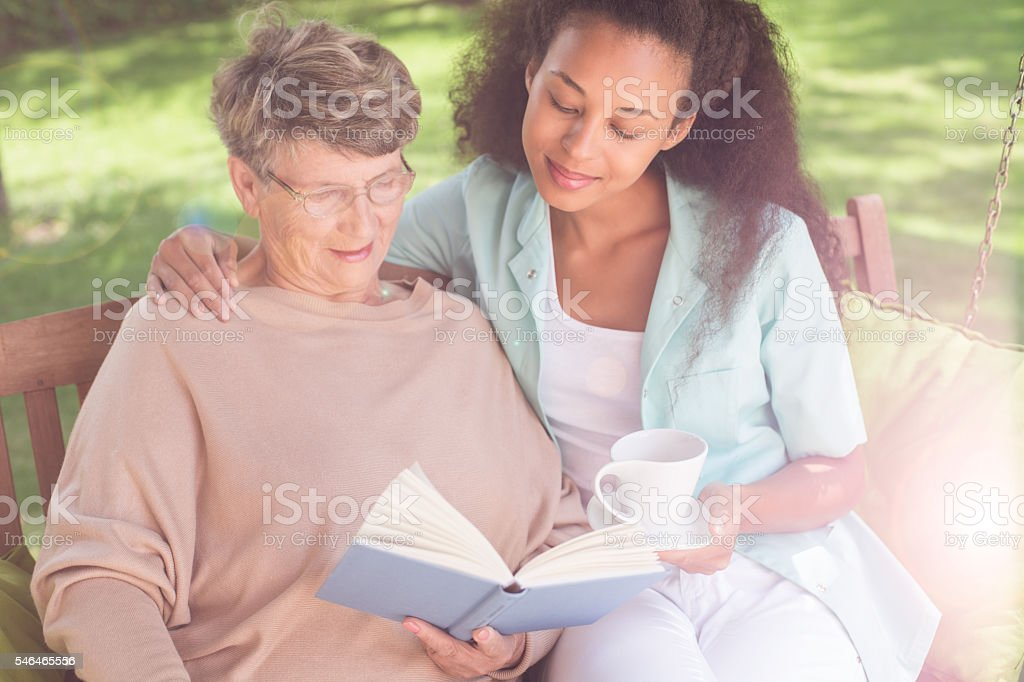 Helpful afroamerican carer stock photo