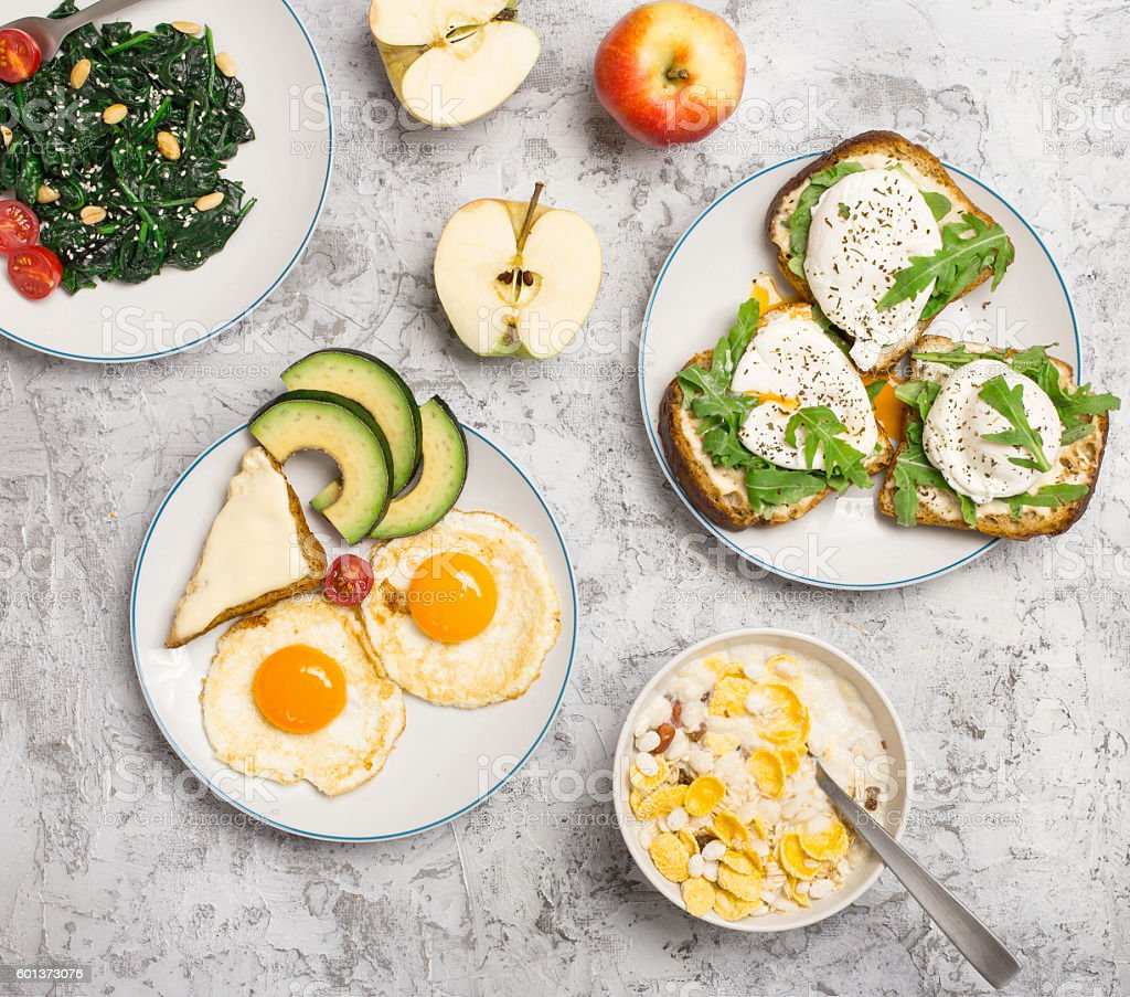 Helpful breakfast from different of dishes on light surface stock photo