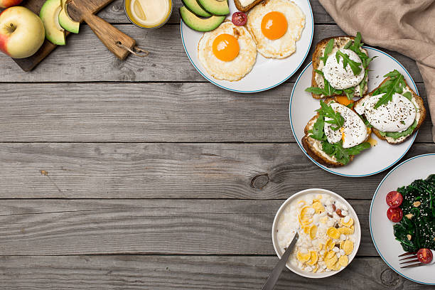Helpful breakfast from different of dishes on wooden table stock photo