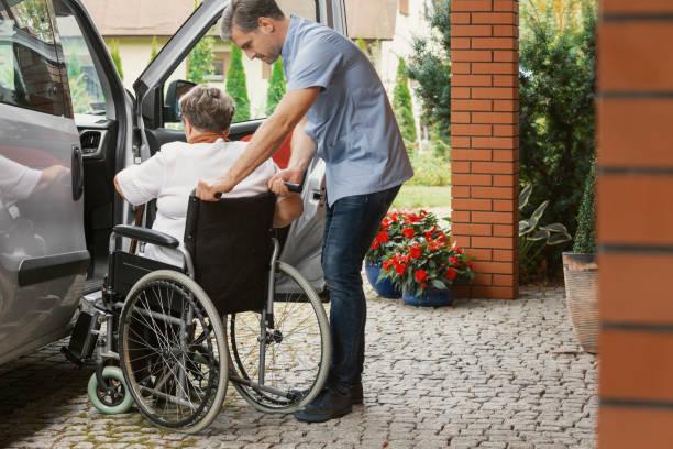 Helpful male nurse with senior lady on wheelchair helping her get in picture id1082955788?b=1&k=6&m=1082955788&s=612x612&w=0&h=rekutrk75ah30o7rehnpy1omc5kiymppu3s0cv1dpdq=