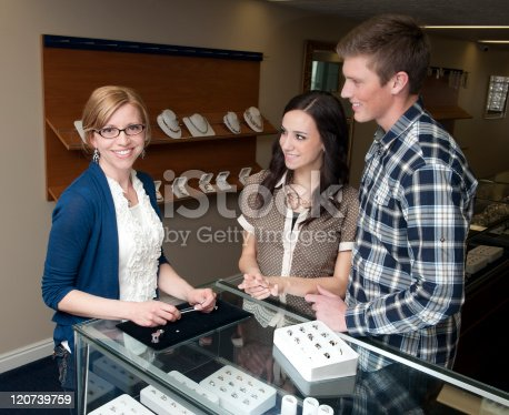478253473istockphoto Helpful sales clerk 120739759