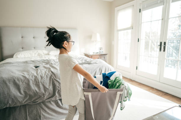 helping child - household chores stock photos and pictures