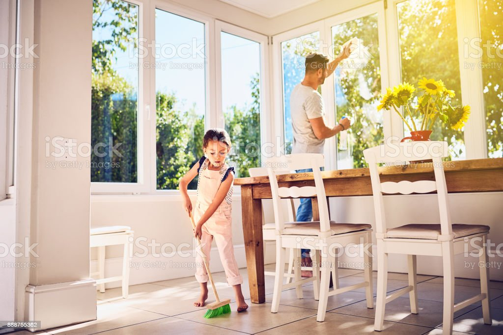 Helping Dad with some spring cleaning around the house stock photo
