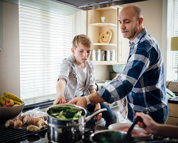 Helping Dad with the Cooking stock photo
