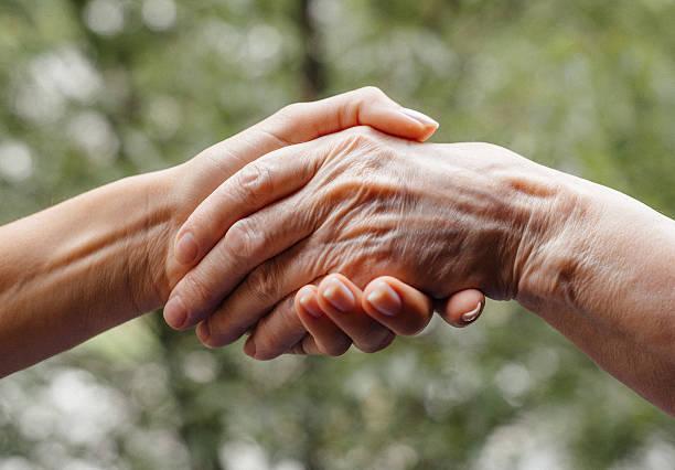 helfende hand für senioren - sexy granny stock-fotos und bilder