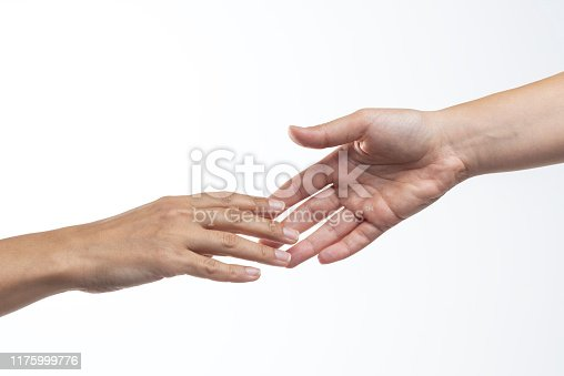 Two hands are almost touching for handshake on white background.