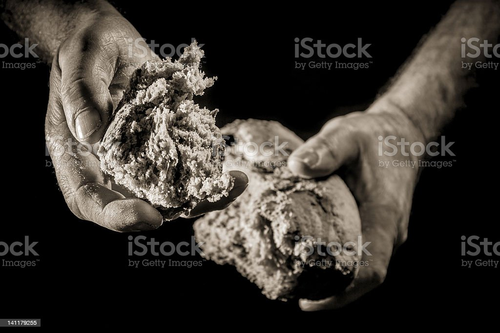 Helping hand with piece of bread stock photo