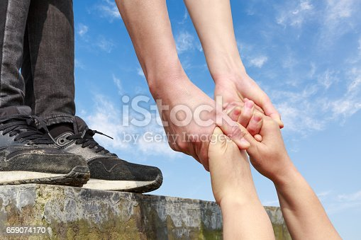 istock helping hand with the sky 659074170