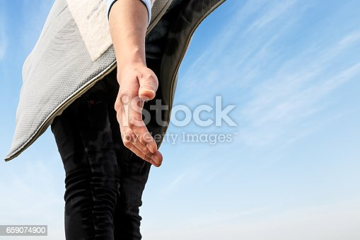 istock helping hand with the sky 659074900