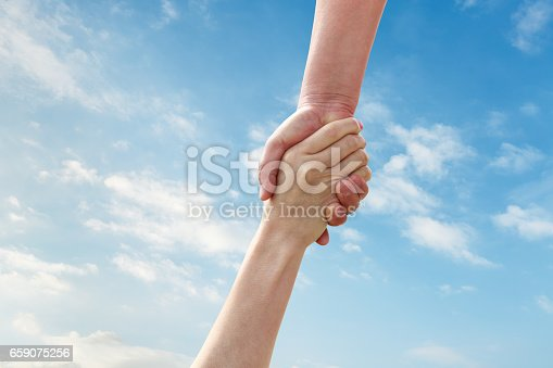 istock helping hand with the sky 659075256