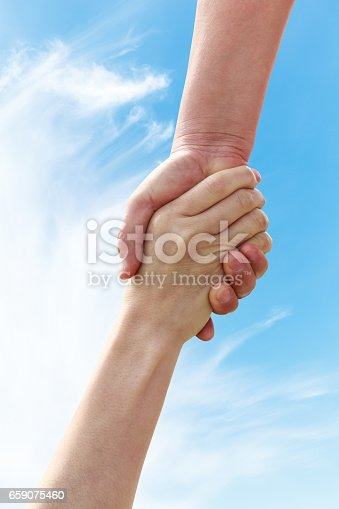 istock helping hand with the sky 659075460