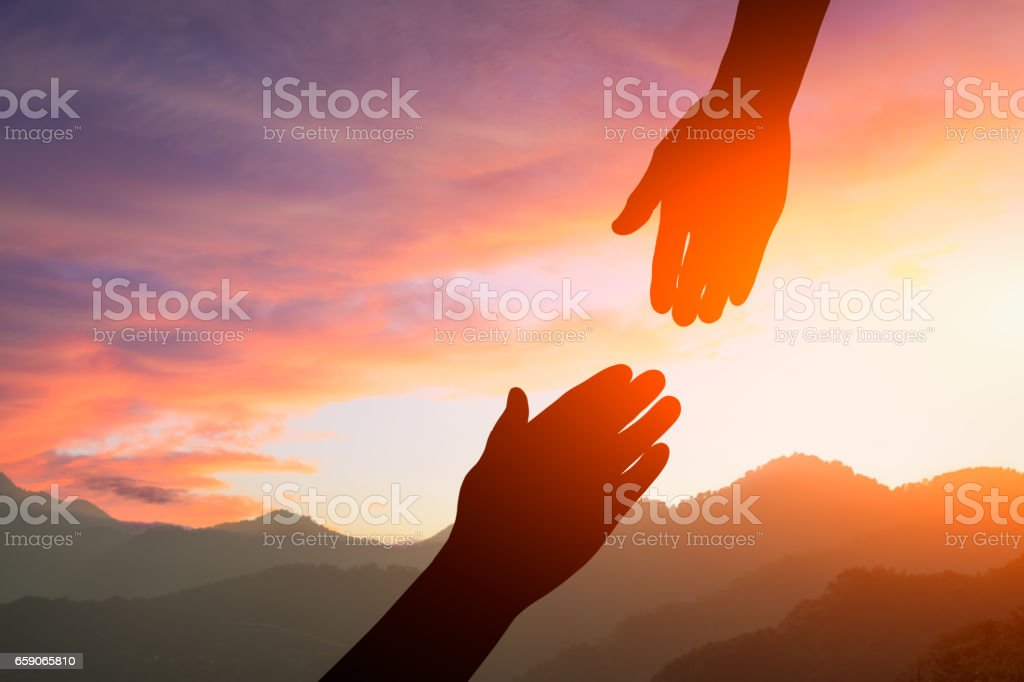 helping hand with the sky sunset stock photo