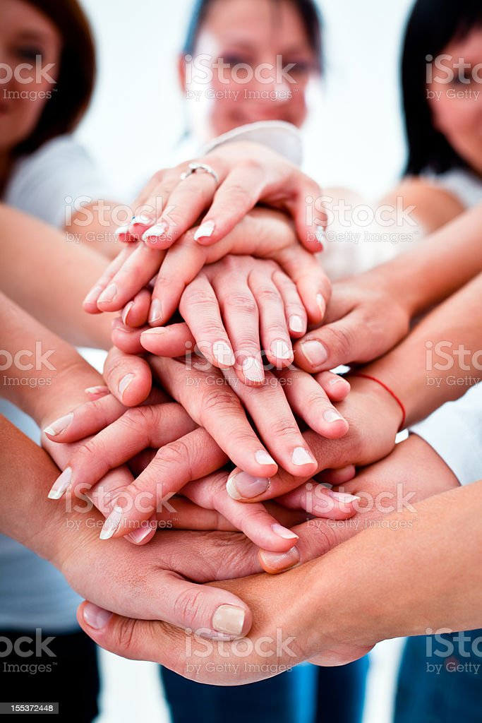 Helping hands Teamwork concept. Women putting their hands on top of eatch other. A Helping Hand Stock Photo