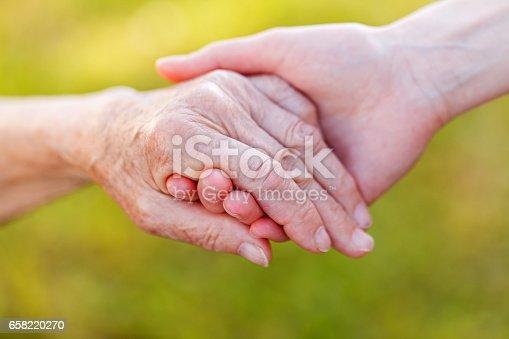 istock Helping hands 658220270