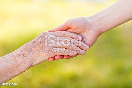 istock Helping hands 658221306