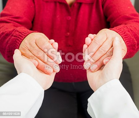 499062115istockphoto Helping hands 664991608