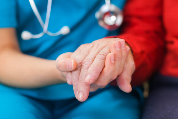 helping hands - elderly patients stock photos and pictures