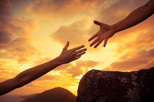 istock Helping hands 817147780