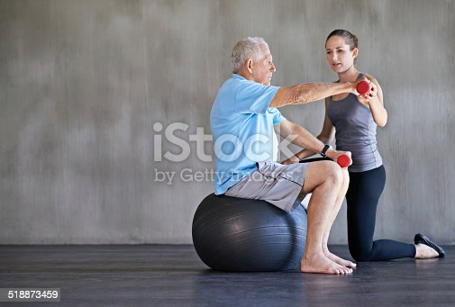 517995977 istock photo Helping her patients stay strong and healthy 518873459